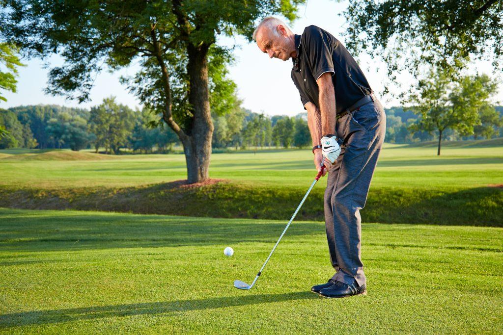 golfer hits a ball