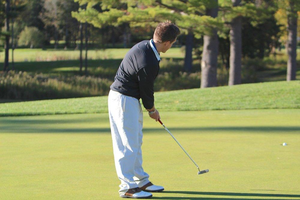 A golfer sinks