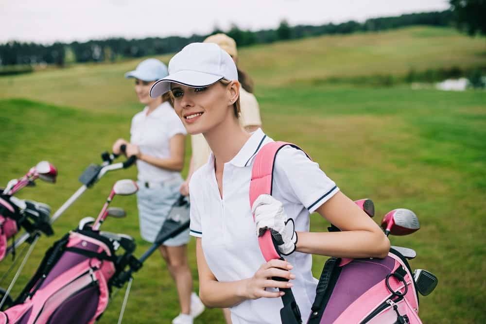 smiling women in golf cap
