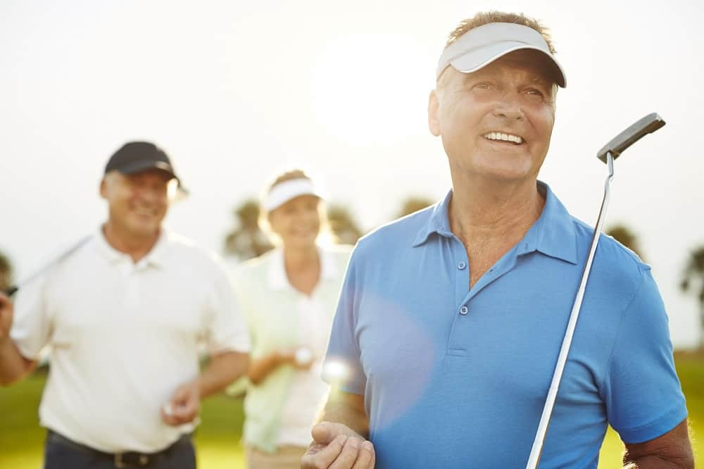 Senior adults on golf course